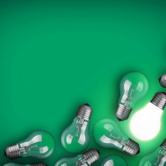 Lightbulbs On Green Background